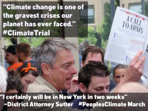 District Attorney Sam Sutter holds up Bill McKibben's article in Rolling Stone after dropping criminal charges for Ken Ward and Jay O'Hara, who used a little white lobster boat to blockade 40,000 tons of coal last spring.