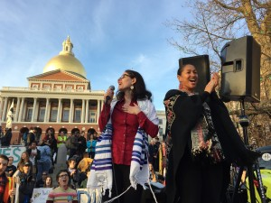 Rabbi Shoshana Meira Friedman leads singing with rally MC, Mariama White Hammond