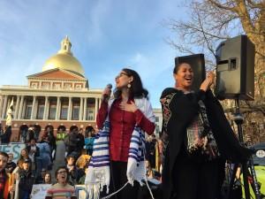 Rabbi Shoshana Meira Friedman leads singing with rally MC, Mariama White Hammond