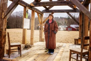 Margaret stands in the 10 x 15 foot cabin in Ashfield modeled by Will Elwell after Thoreau's cabin at Walden Pond, photo by Robert A. Jonas