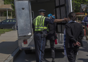 Getting into the police van, with Shoshana next in line (photo credit: Robert A. Jonas)
