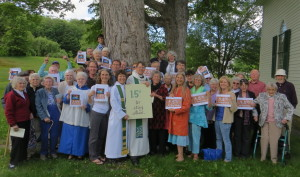 Ecumenical witness for climate justice in Ashfield, MA. Holding the sign: Rev. Margaret Bullitt-Jonas, Rev. Eliot Moss (St. John's Episcopal Church), Rev. Kate Stevens (First Congregational Church)