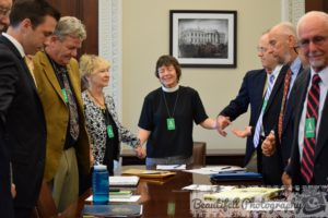 Praying with members of National Religious Coalition on Creation Care and of White House Council on Environmental Quality. Photo credit: Beautifell Photography by Christine Ellman