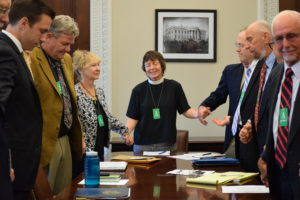 Margaret prays at the end of a meeting with members of National Religious Coalition on Creation Care and of White House Council on Environmental Quality. Photo credit: Beautifell Photography by Christine Ellman