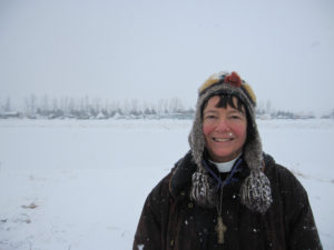 Standing at the edge of Oceti Sakowin Camp on Monday, 12/5/16, as a blizzard began to blow in. Beyond the river behind me are Rosebud Camp and Sacred Stone Camp.
